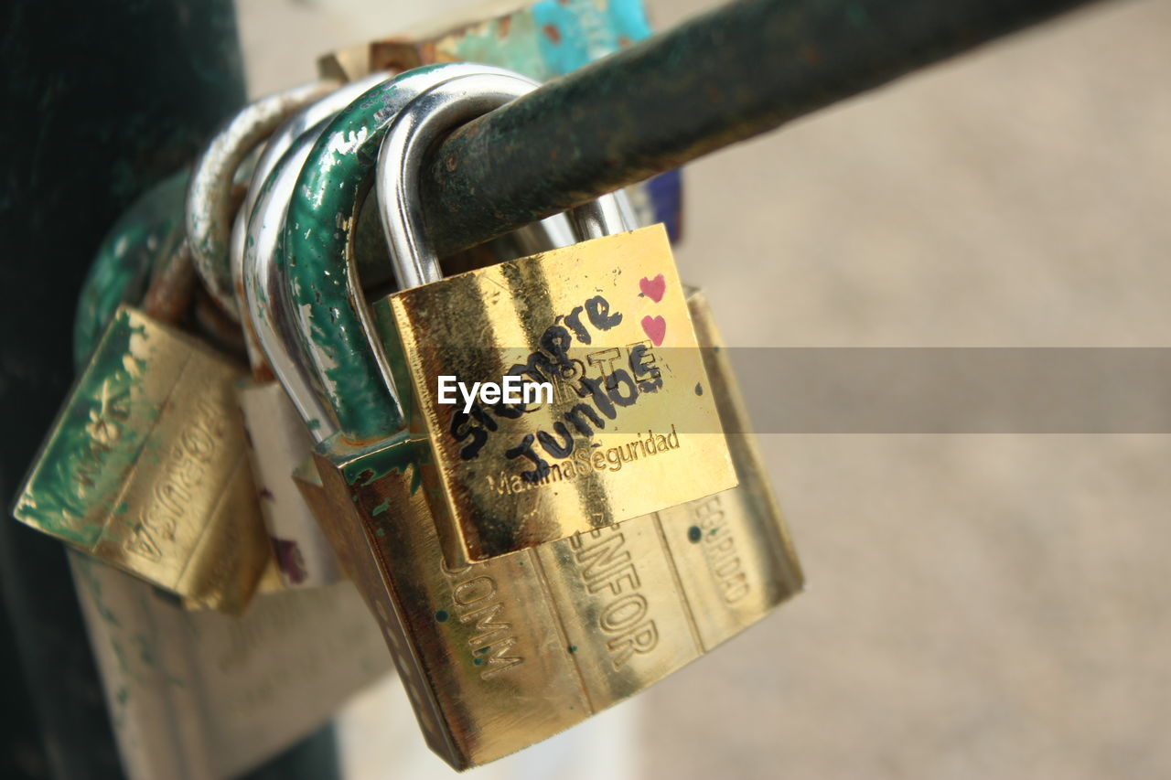 padlock, lock, security, safety, love, hanging, hope, metal, love lock, close-up, protection, luck, communication, focus on foreground, text, hope - concept, no people, gold colored, wealth, day, outdoors