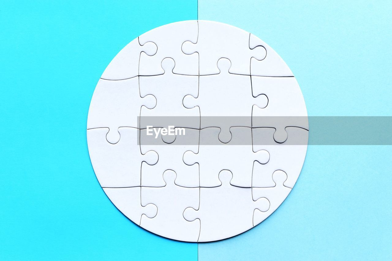 jigsaw piece, puzzle, blue, shape, jigsaw puzzle, indoors, solution, no people, pattern, white color, studio shot, design, connection, blue background, geometric shape, strategy, relaxation, leisure activity, circle, close-up