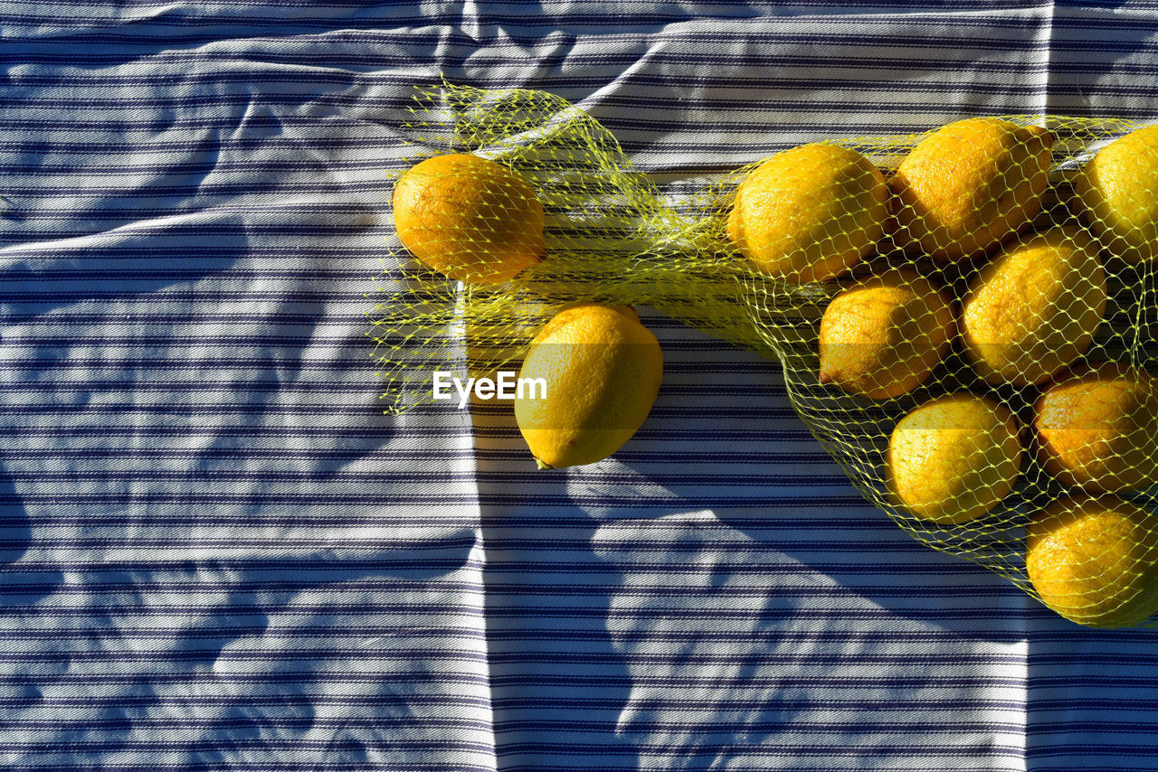 fruit, healthy eating, wellbeing, no people, freshness, food and drink, food, yellow, day, close-up, sunlight, citrus fruit, nature, lemon, outdoors, hanging, still life, growth, plant, shadow, ripe