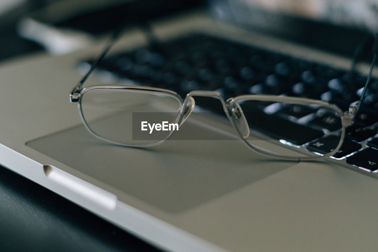 Close-Up Of Eyeglasses On Laptop