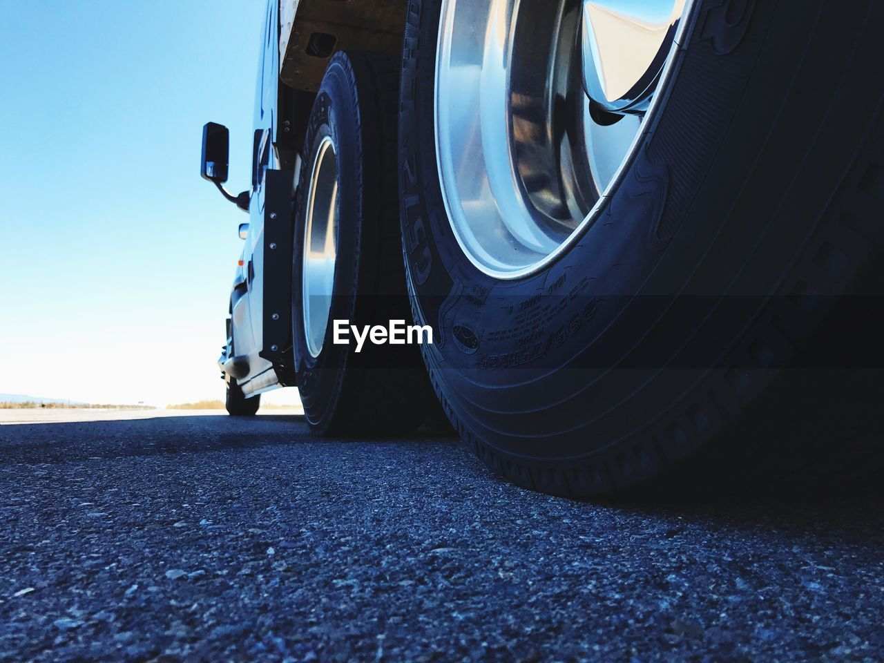 transportation, mode of transport, land vehicle, tire, road, car, no people, day, wheel, low section, outdoors, close-up, sky