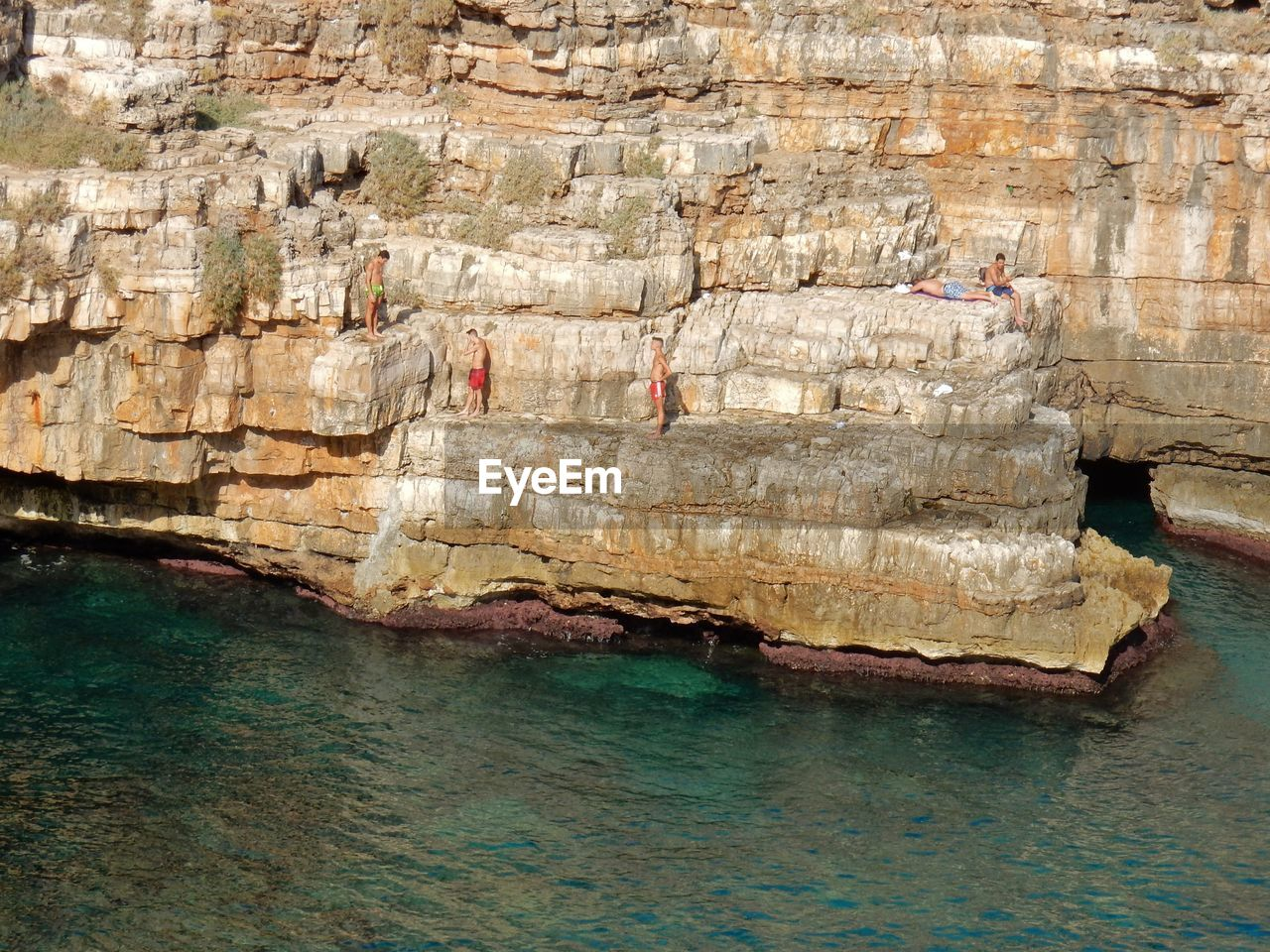 water, sea, waterfront, solid, rock formation, nature, rock, rock - object, day, beauty in nature, scenics - nature, land, outdoors, architecture, real people, cliff, travel, tourism, tranquility
