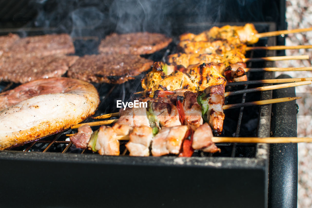 Chickens Cooking On Barbecue Grill