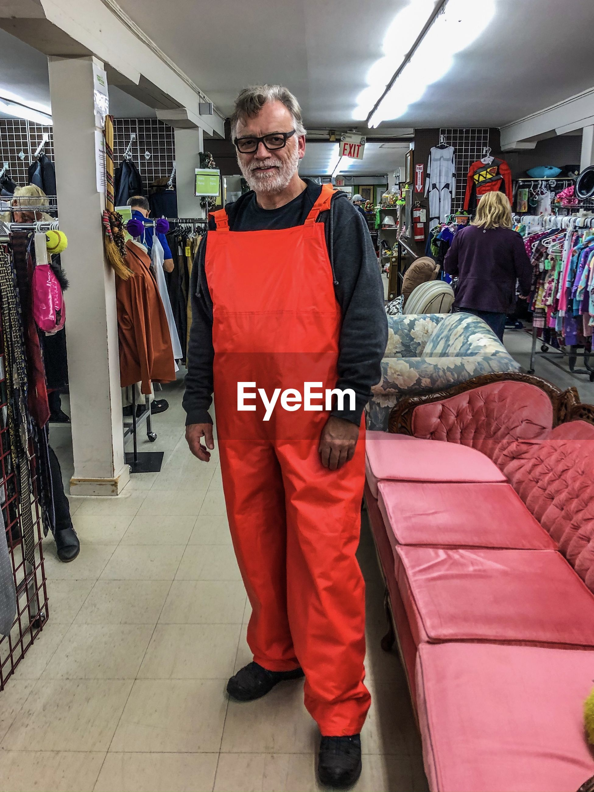 FULL LENGTH OF MAN STANDING IN STORE AT SHOP