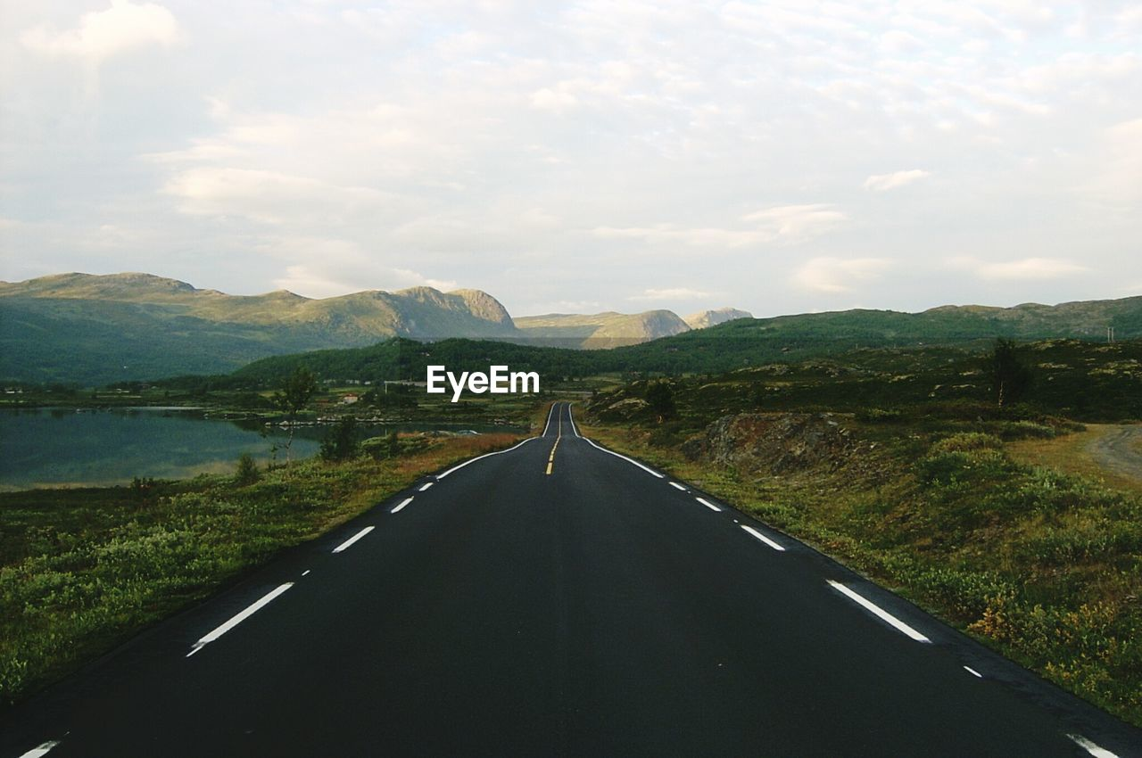 Highway In Mountains Against Sky