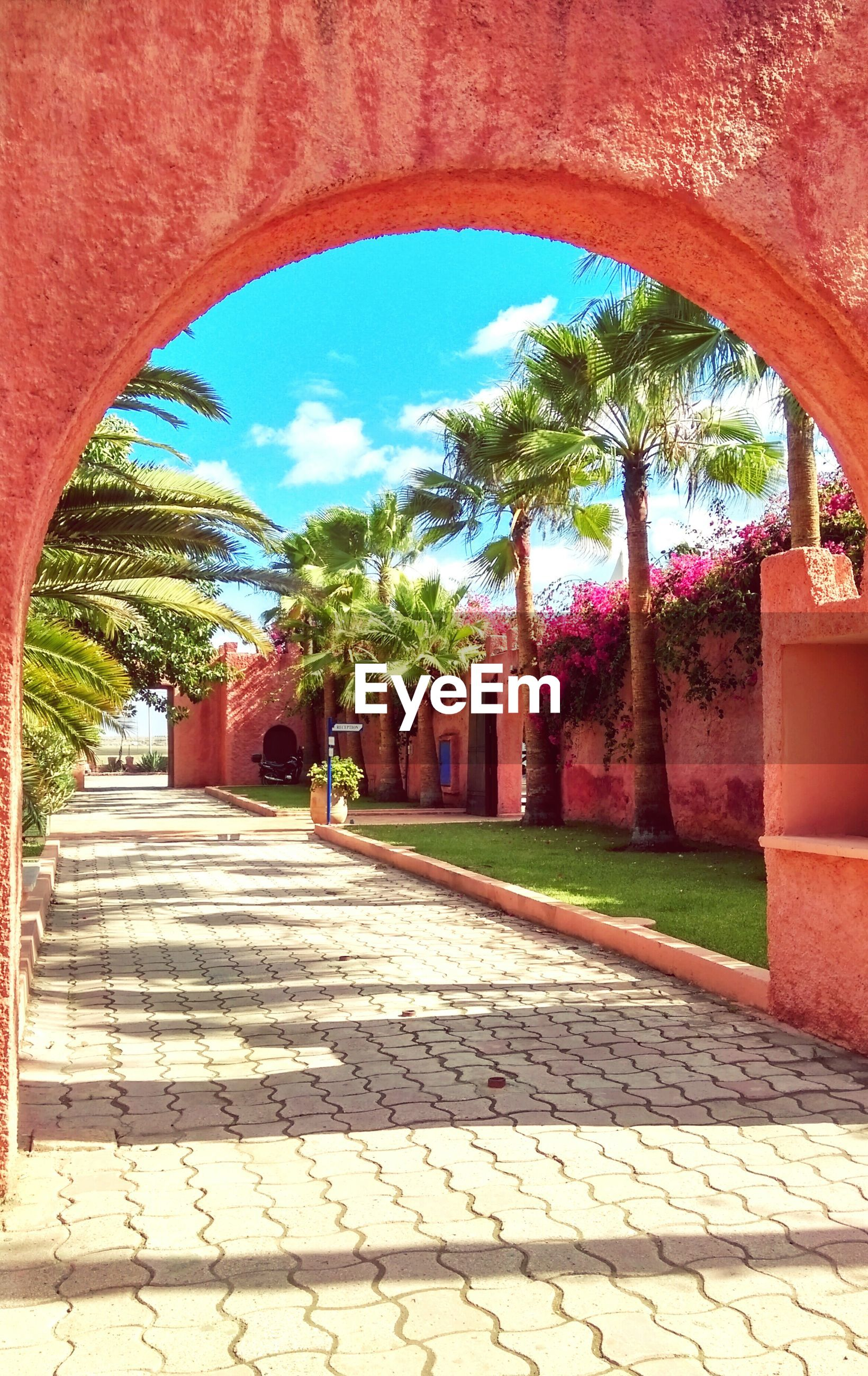 Coral colored archway over footpath