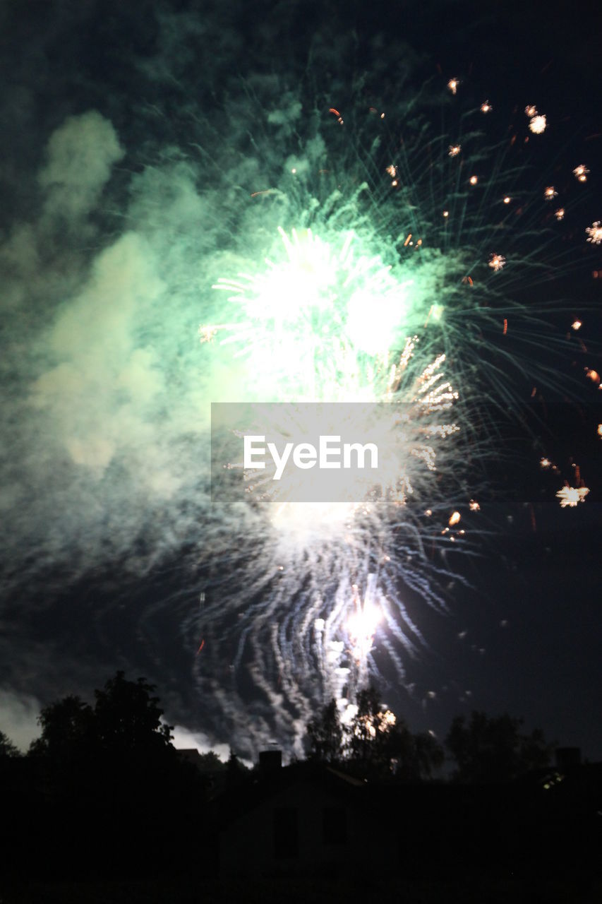 night, illuminated, firework, celebration, event, exploding, sky, firework display, motion, glowing, no people, low angle view, arts culture and entertainment, light, nature, long exposure, silhouette, outdoors, smoke - physical structure, firework - man made object, explosive, festival