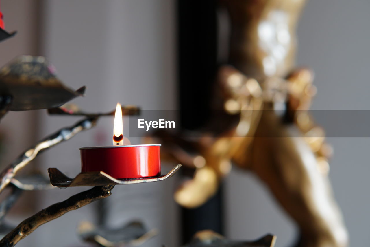 flame, fire, burning, candle, indoors, close-up, fire - natural phenomenon, illuminated, heat - temperature, no people, selective focus, glowing, focus on foreground, metal, nature, religion, spirituality, belief, celebration, lighting equipment