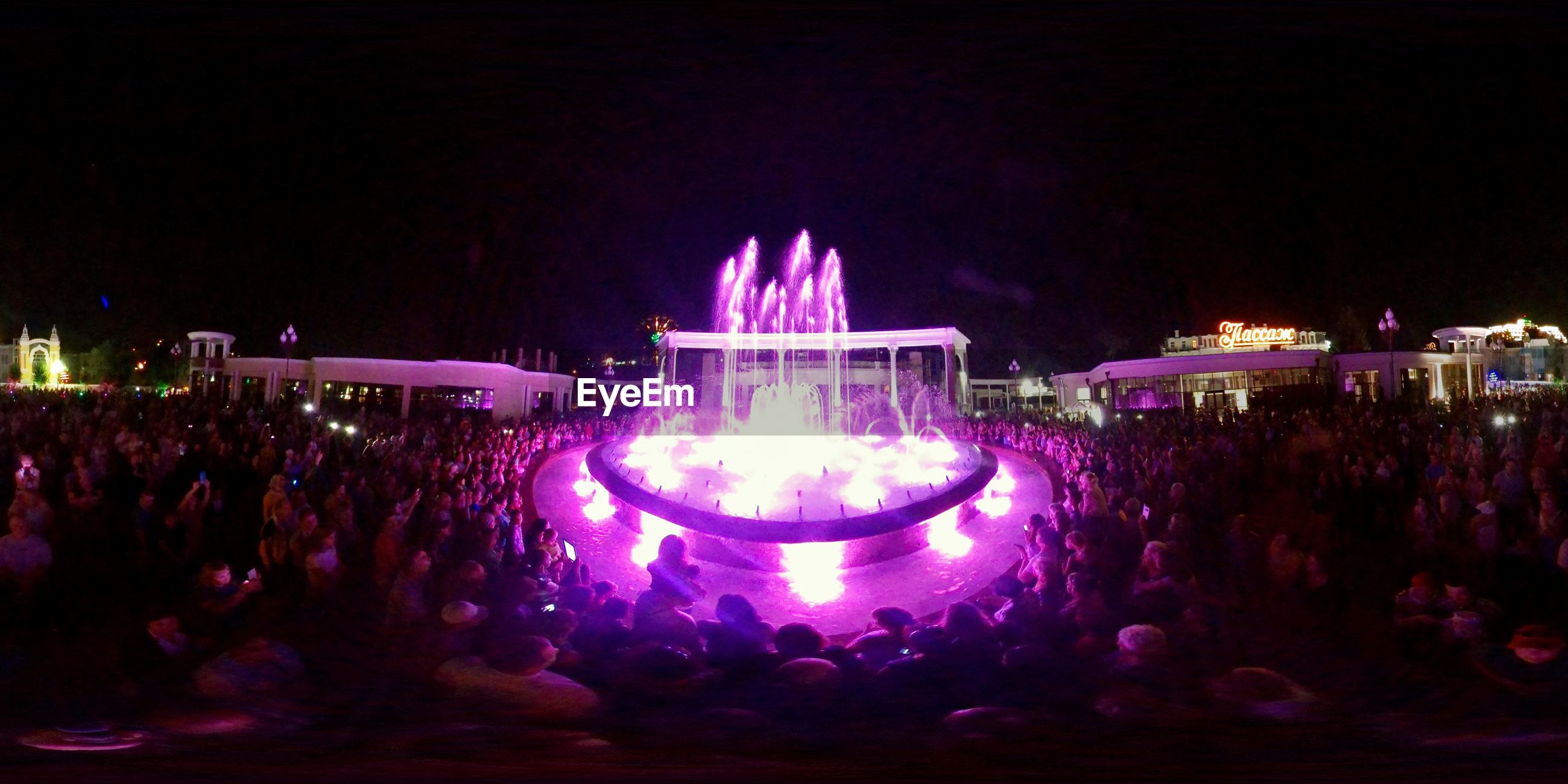 large group of people, illuminated, night, arts culture and entertainment, enjoyment, togetherness, crowd, performance, leisure activity, event, person, nightlife, fun, stage light, in front of, stage - performance space, sky, enjoying, spotlight, popular music concert