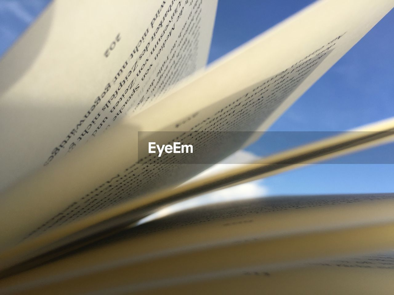 paper, close-up, book, page, publication, selective focus, still life, education, no people, open, indoors, shadow, text, expertise, sunlight, learning, literature, document, white color, communication