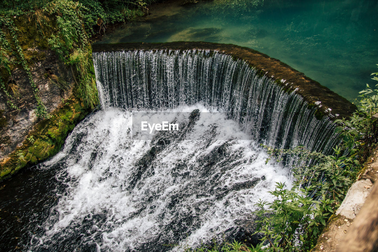 water, motion, beauty in nature, scenics - nature, flowing water, waterfall, long exposure, nature, blurred motion, no people, splashing, high angle view, day, power in nature, environment, river, power, sport, flowing, outdoors