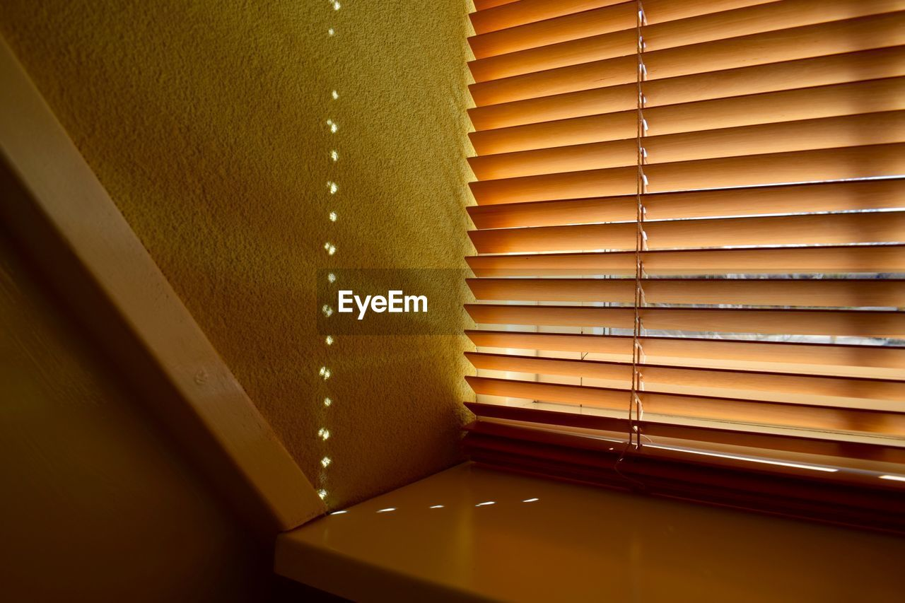 indoors, window, ceiling, no people, architecture, illuminated, yellow, pattern, architectural design, built structure, blinds, multi colored, close-up, home showcase interior, day