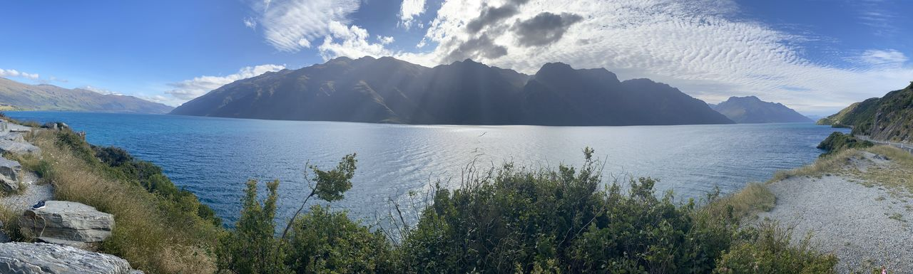 water, sky, beauty in nature, scenics - nature, mountain, tranquility, tranquil scene, cloud - sky, sea, nature, plant, non-urban scene, day, no people, panoramic, idyllic, tree, rock, outdoors