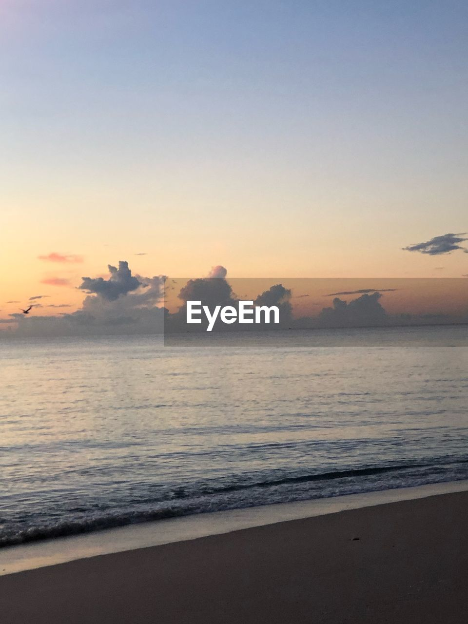 sky, water, sea, beauty in nature, scenics - nature, beach, sunset, tranquility, land, tranquil scene, horizon, horizon over water, cloud - sky, idyllic, no people, nature, wave, motion, sand, outdoors