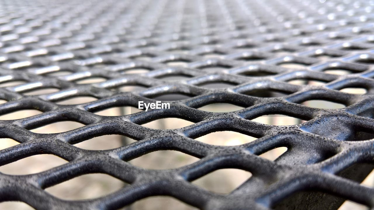 full frame, metal, backgrounds, close-up, pattern, no people, fence, grid, boundary, textured, barrier, safety, selective focus, repetition, security, grate, protection, focus on foreground, metal grate, day, silver colored, crisscross