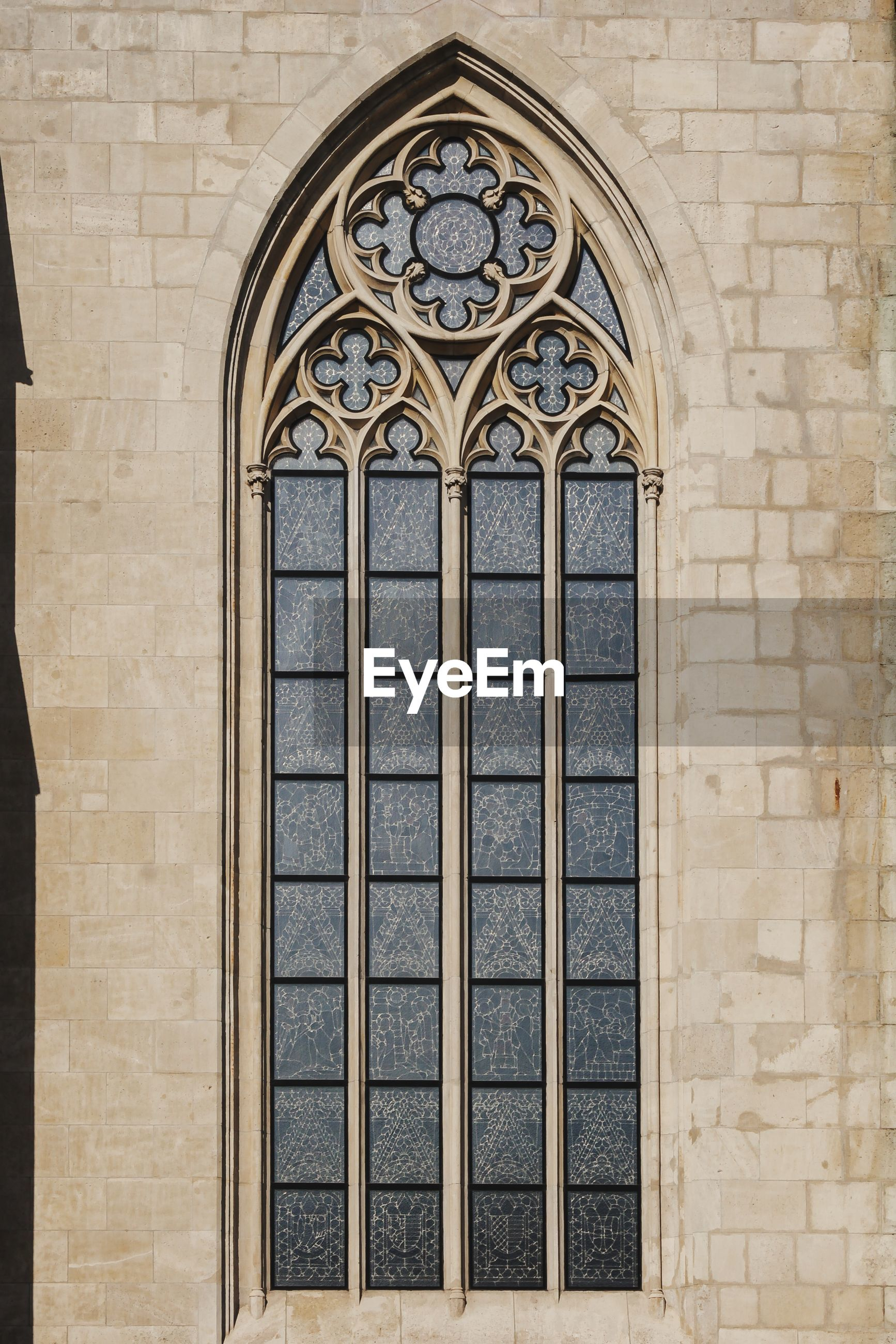 View of ornate window on wall of cathedral