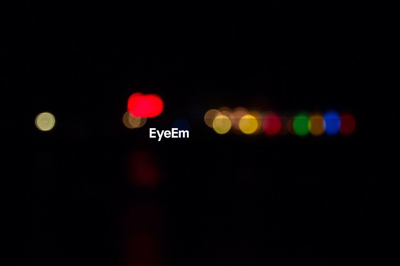 Illuminated Defocused Colorful Lights At Night