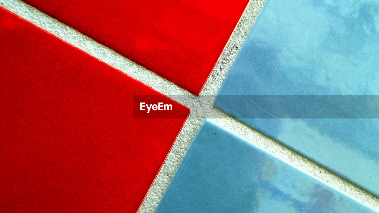 Close-Up Of Blue And Red Tiles On Wall