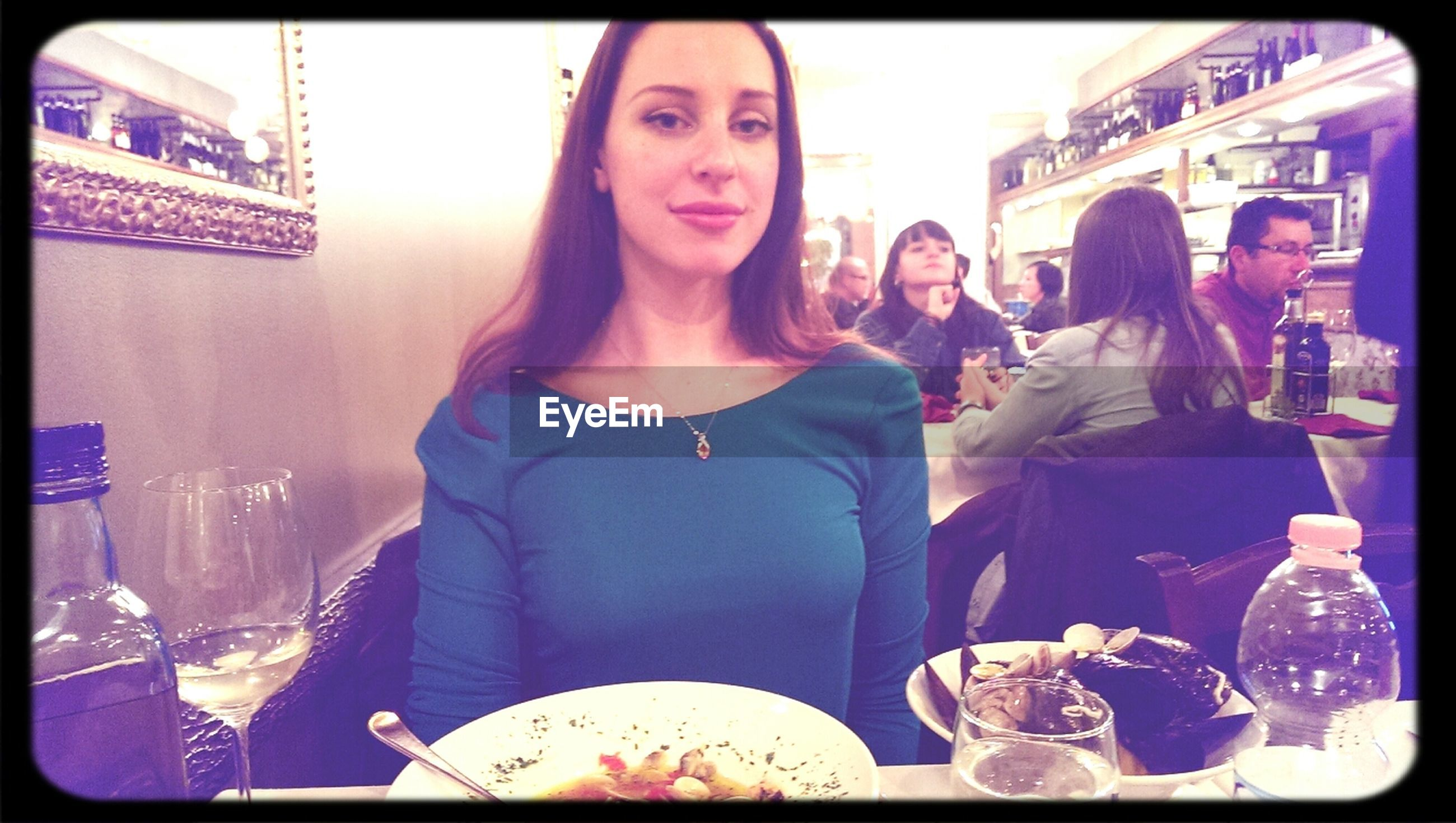 indoors, transfer print, lifestyles, casual clothing, leisure activity, food and drink, person, young adult, auto post production filter, restaurant, front view, drink, young men, portrait, waist up, sitting, looking at camera, holding
