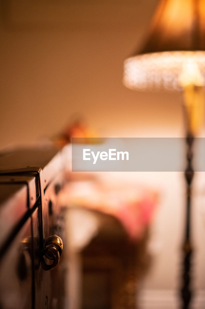 selective focus, indoors, lighting equipment, no people, close-up, musical instrument, music, illuminated, arts culture and entertainment, focus on foreground, musical equipment, metal, home interior, still life, wood - material, electric lamp, old, domestic room, retro styled