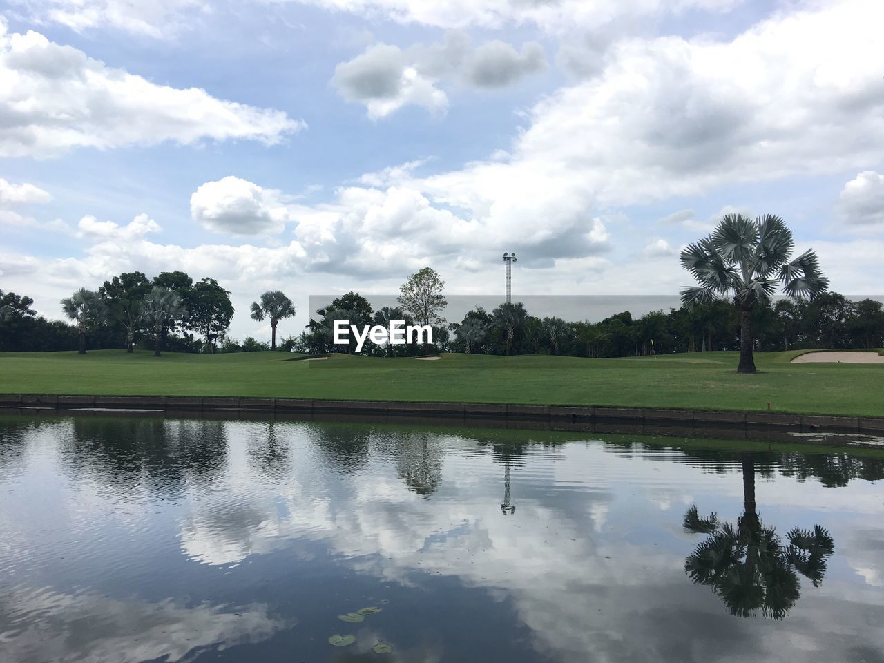 reflection, tree, cloud - sky, sky, water, nature, beauty in nature, tranquility, tranquil scene, lake, day, no people, scenics, outdoors, grass, golf course, golf, green - golf course