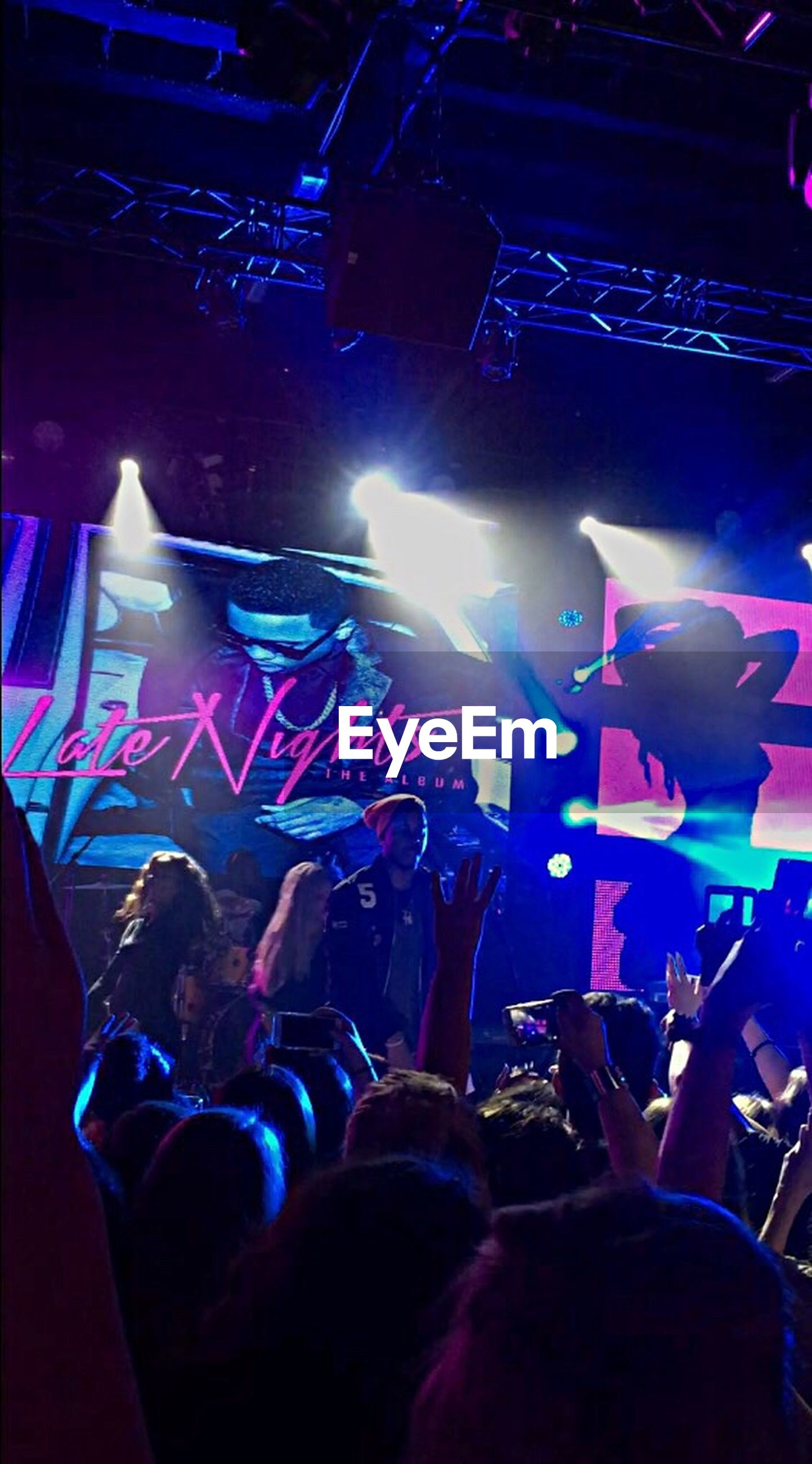 illuminated, large group of people, men, crowd, lifestyles, night, indoors, leisure activity, nightlife, person, music, arts culture and entertainment, performance, youth culture, stage - performance space, event, concert, lighting equipment