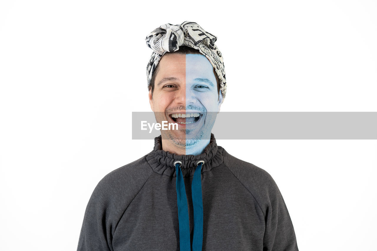 Portrait of smiling man against white background