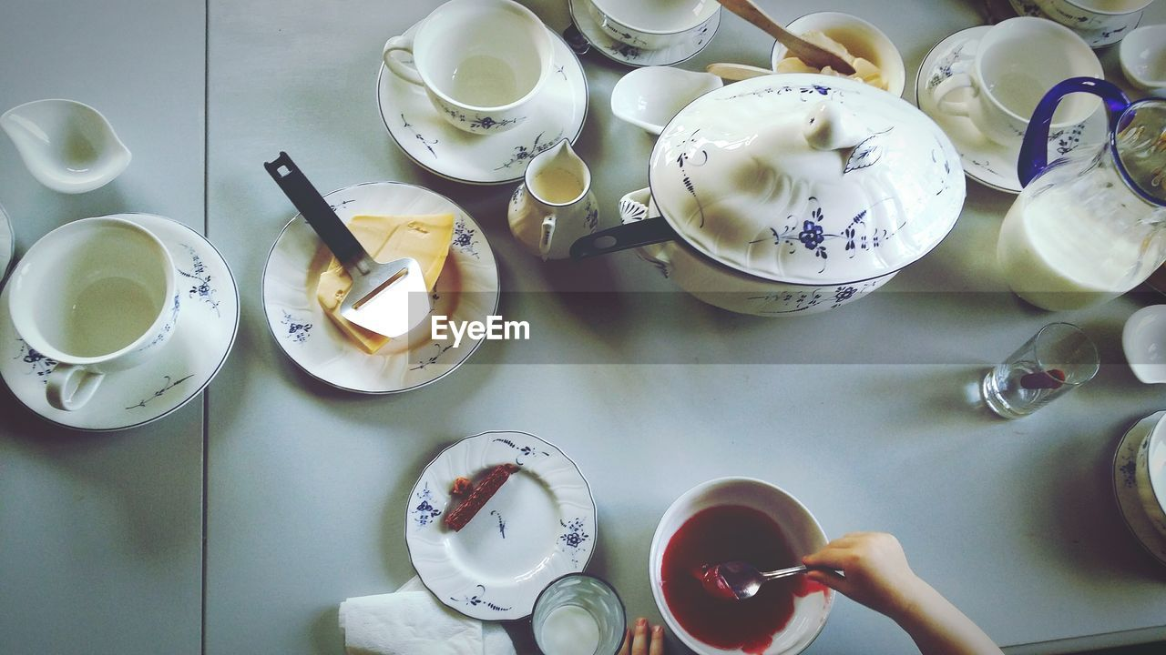 High Angle View Of Ceramic Crockery On Table