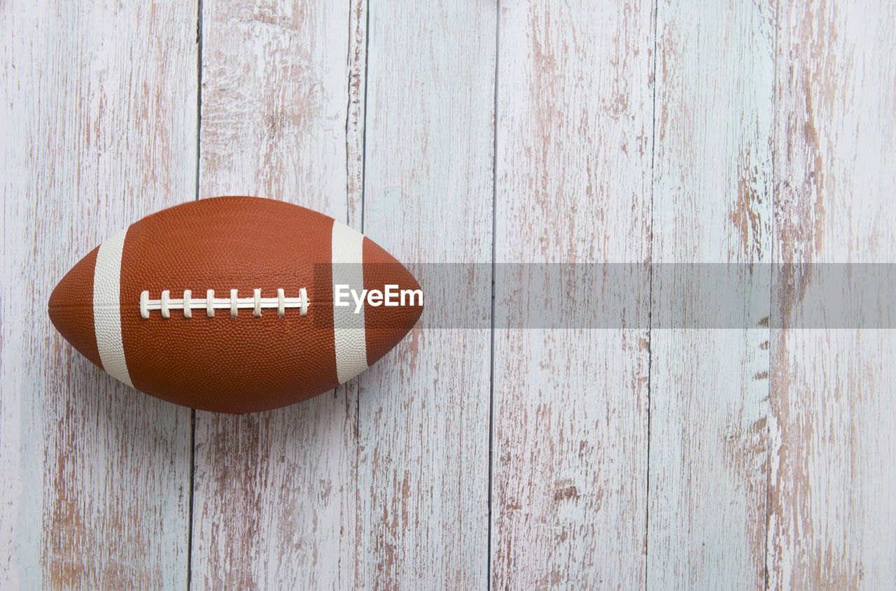 wood - material, brown, no people, textured, directly above, table, close-up, still life, wall - building feature, indoors, single object, communication, day, red, lighting equipment, pattern, sport, food and drink, sports equipment, high angle view