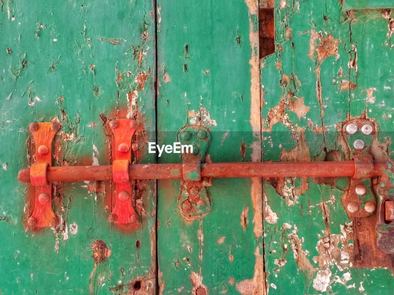 Close-Up Of Rusty Latch On Old Wooden Door