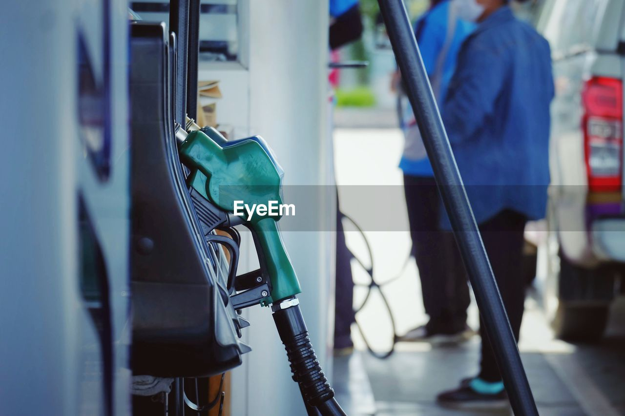 Close-Up Of Fuel Nozzle At Gas Station