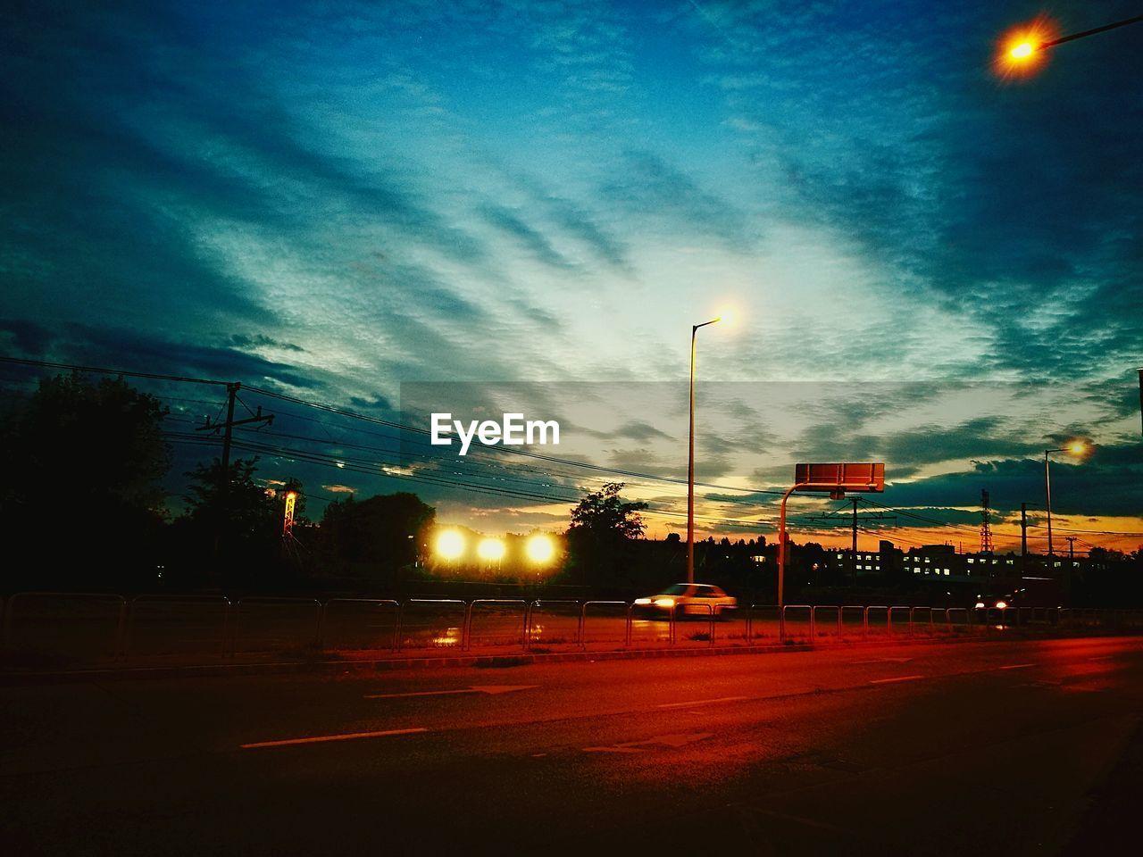 street light, sky, road, illuminated, transportation, no people, dusk, sunset, night, outdoors, electricity pylon, tree, nature