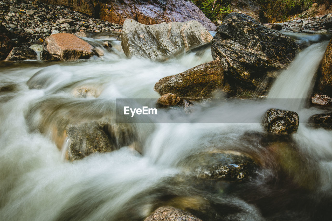 motion, long exposure, water, blurred motion, rock, flowing water, scenics - nature, beauty in nature, rock - object, solid, waterfall, forest, no people, flowing, day, land, nature, aquatic sport, stream - flowing water, outdoors, power in nature, falling water, running water