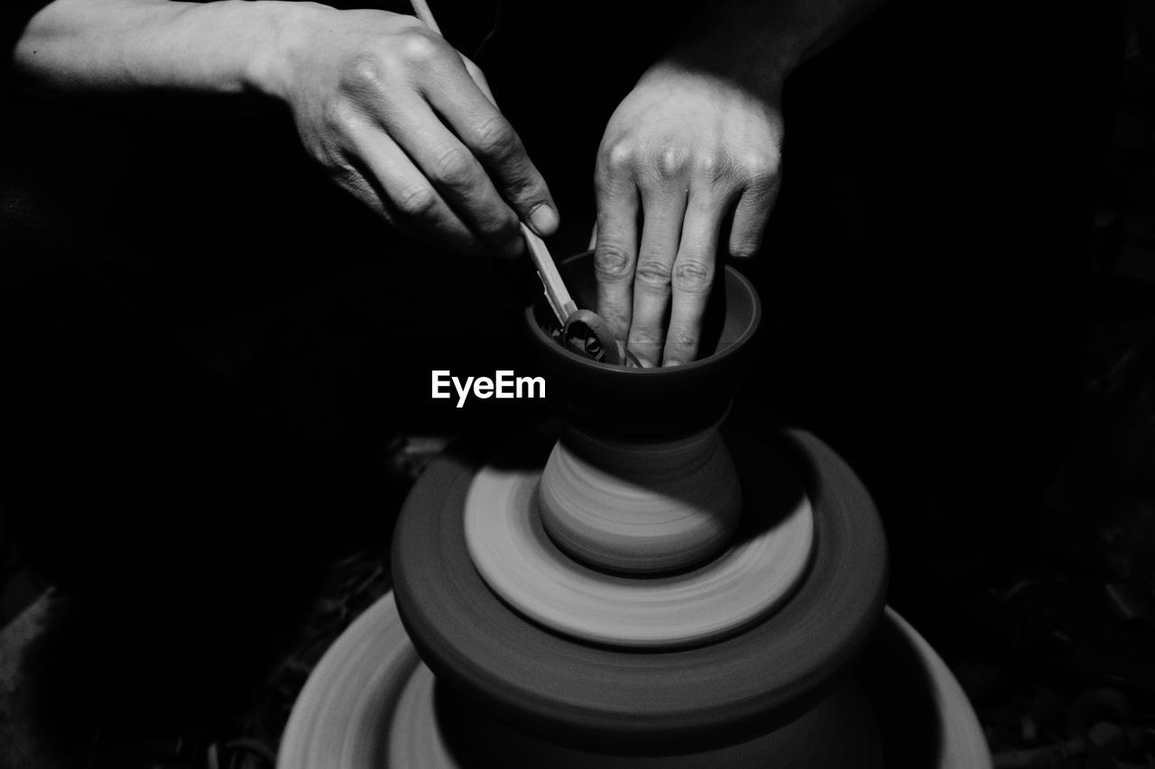 human hand, hand, one person, human body part, real people, holding, spinning, making, skill, craft, art and craft, working, motion, expertise, occupation, indoors, workshop, pottery, creativity, finger, wheel