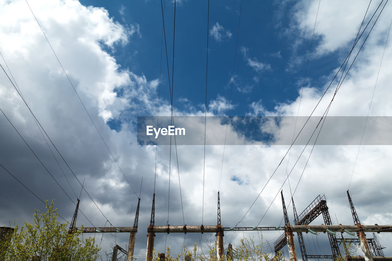 cloud - sky, sky, cable, electricity, connection, nature, day, no people, low angle view, power line, technology, built structure, architecture, power supply, outdoors, fuel and power generation, electricity pylon, metal, barrier, protection, telephone line