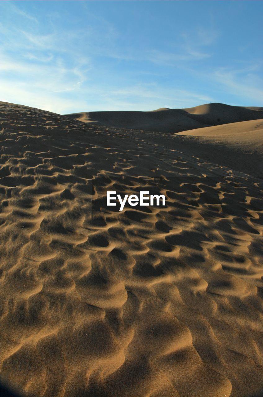 Idyllic Shot Of Sand Dunes In Desert
