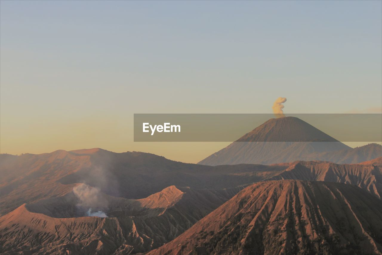 mountain, sky, scenics - nature, beauty in nature, landscape, volcano, tranquil scene, non-urban scene, tranquility, clear sky, environment, no people, land, geology, nature, idyllic, sunset, travel destinations, physical geography, mountain range, outdoors, volcanic crater, climate, mountain peak, arid climate, power in nature