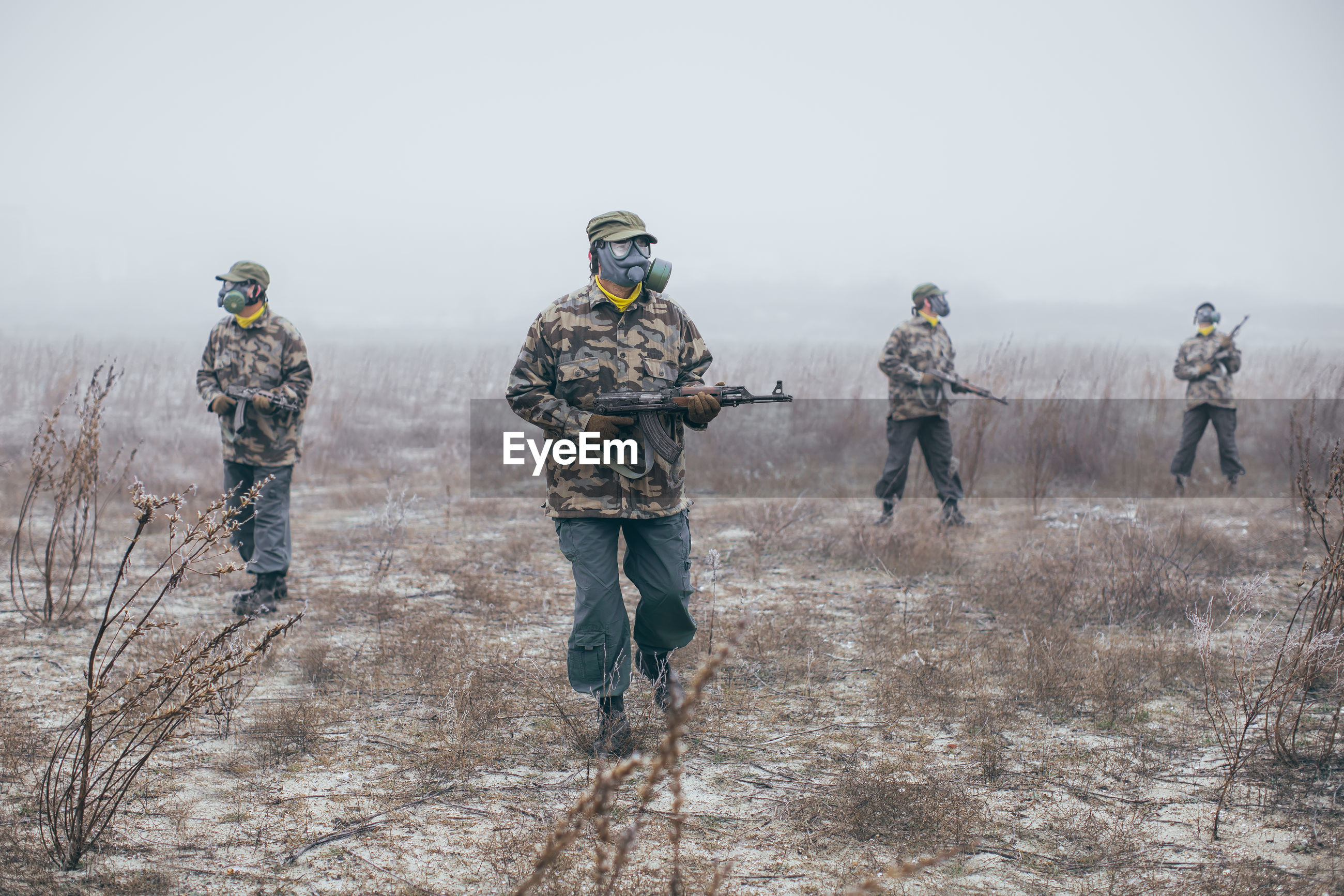 Soldiers walking through field looking for enemy
