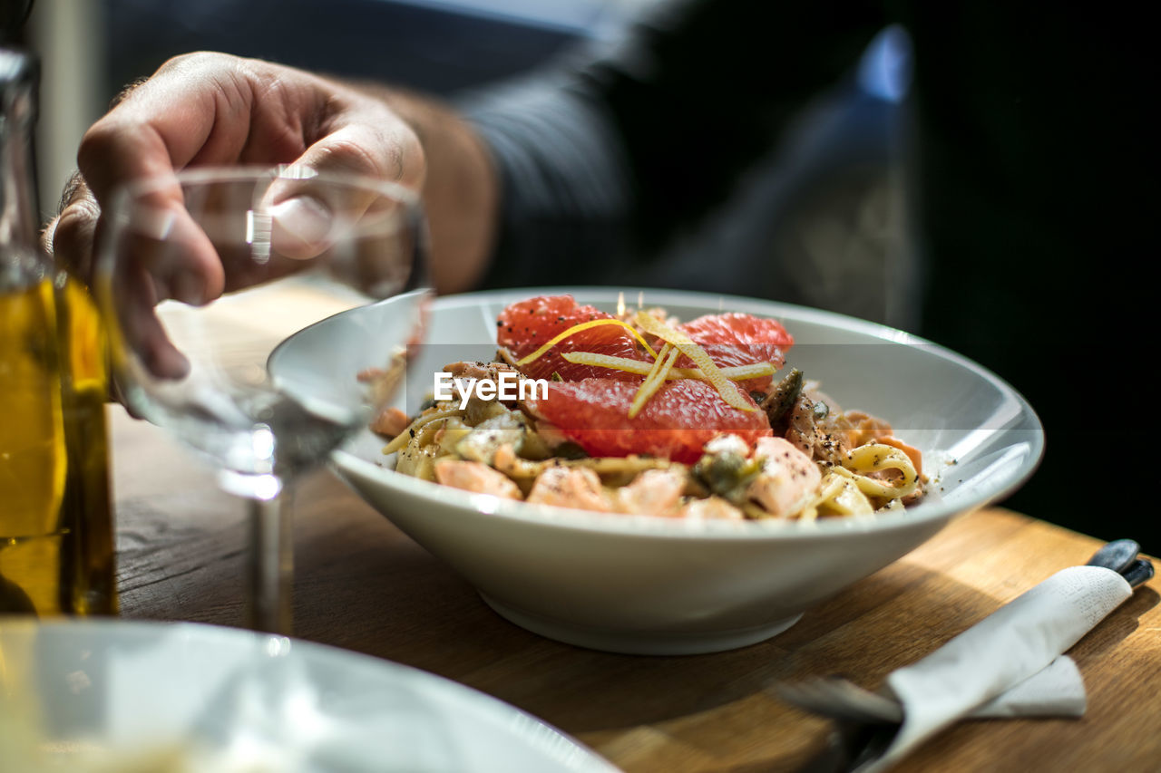 Close-up of man with pasta in bowl