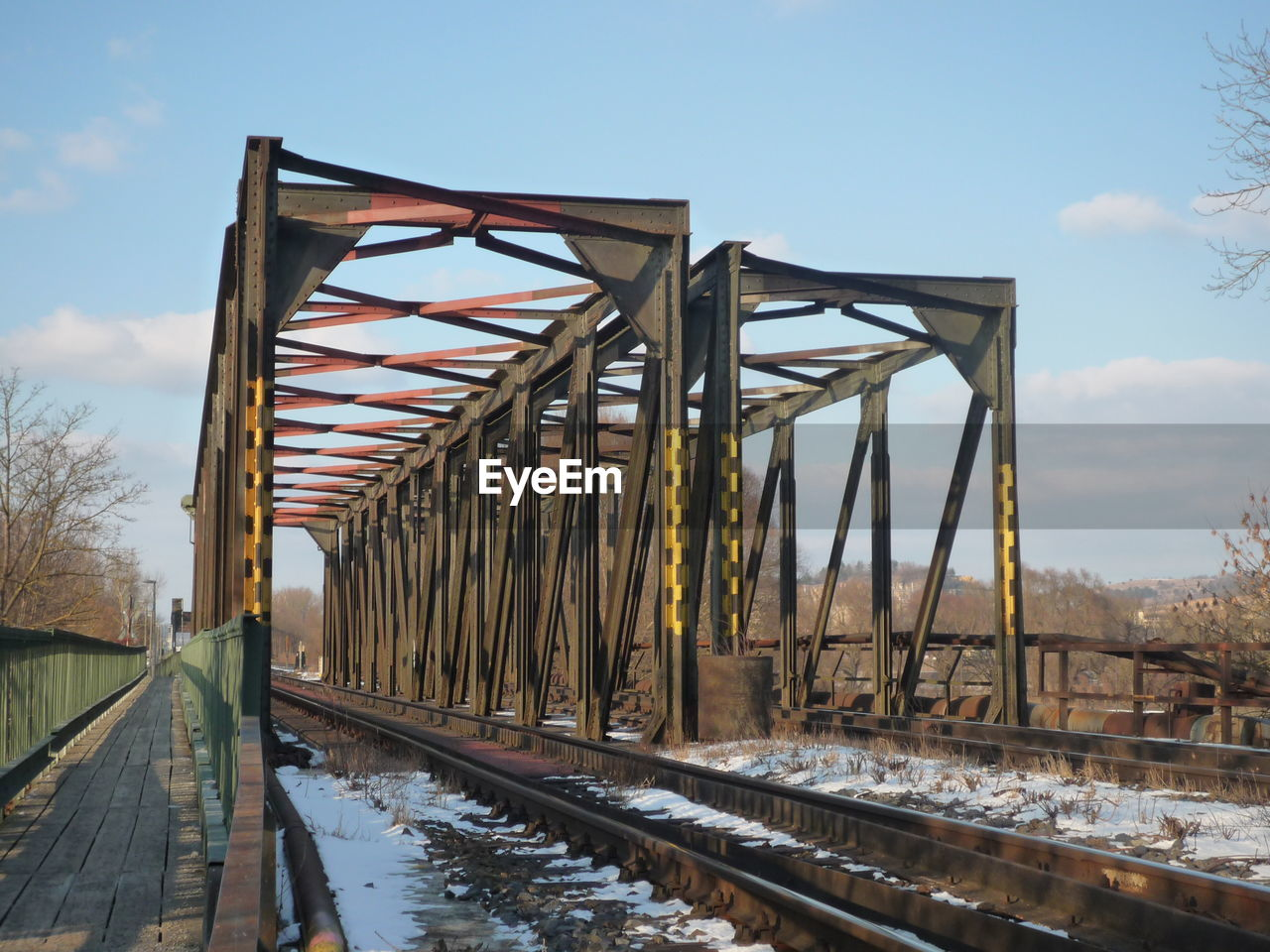 rail transportation, transportation, railroad track, sky, day, outdoors, bridge - man made structure, cloud - sky, built structure, architecture, no people, water, nature