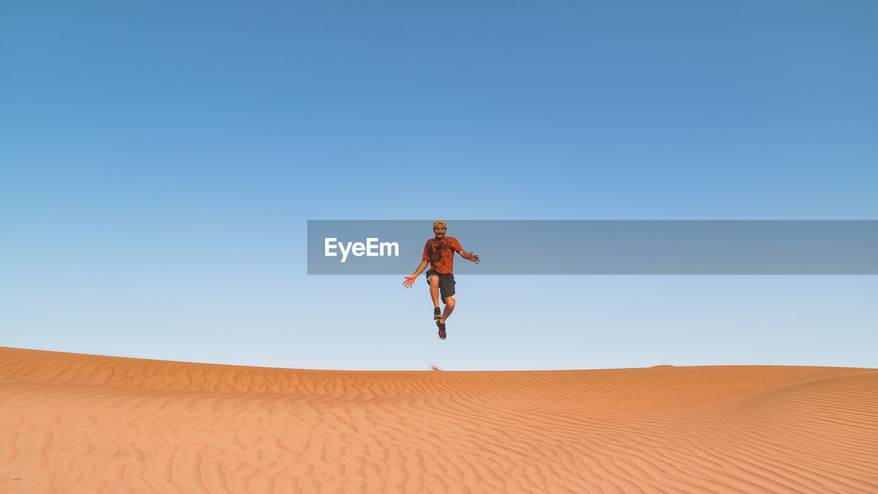 Man Jumping Against Clear Sky
