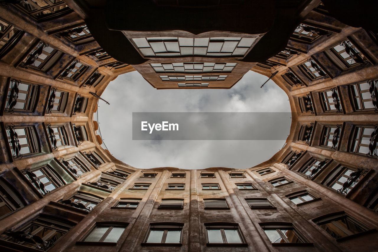 architecture, built structure, low angle view, building exterior, sky, no people, directly below, cloud - sky, window, building, ceiling, shape, day, geometric shape, outdoors, nature, city, digital composite, luxury