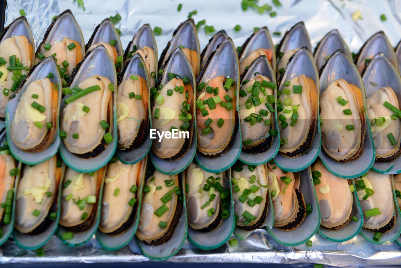 Close-Up Of Mussels In Aluminum Foil