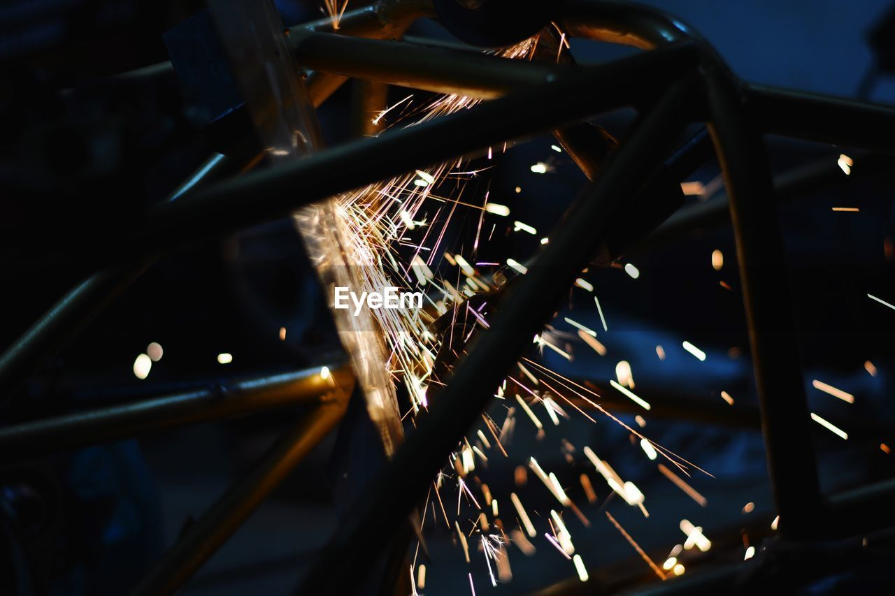 Sparks Emitting From Machinery At Night