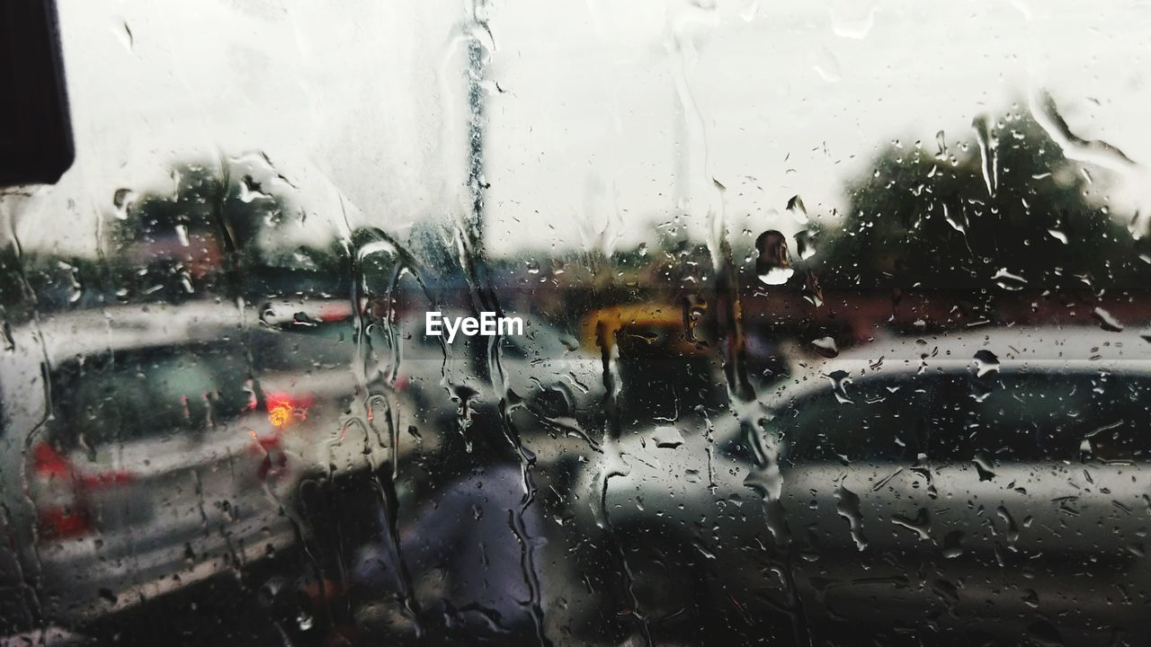 Wet window of car during rainy season