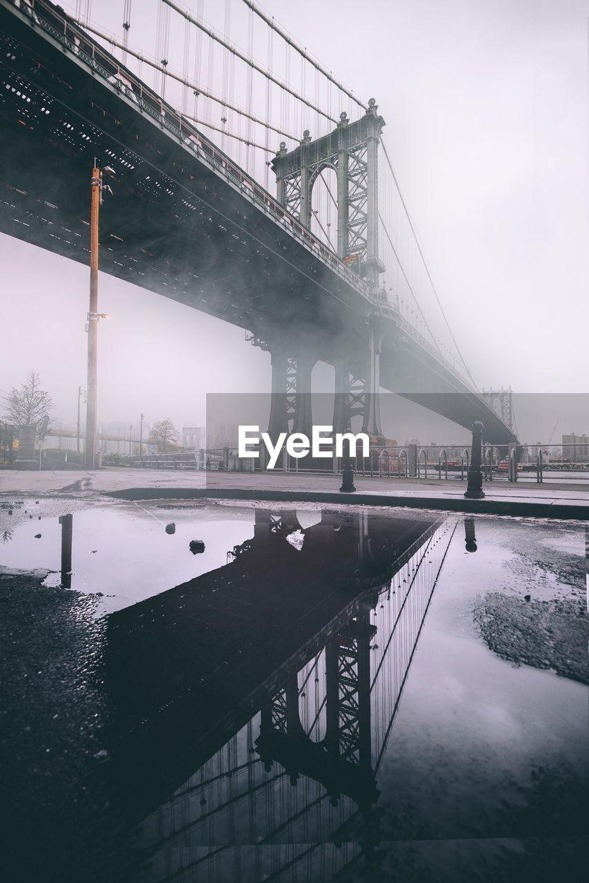 Manhattan Bridge Against Sky In City During Winter