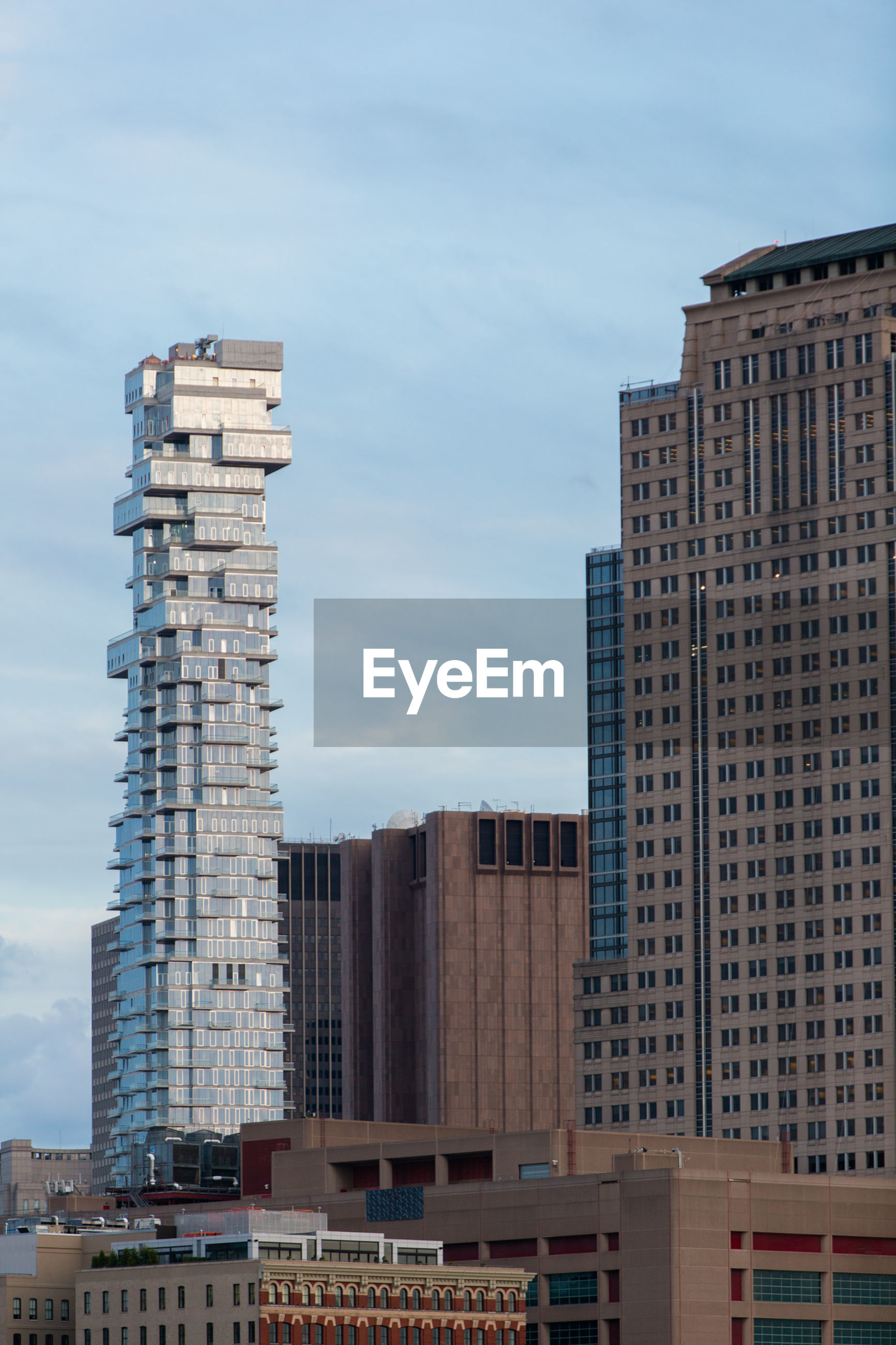building exterior, architecture, built structure, city, sky, no people, skyscraper, outdoors, day, development, cloud - sky