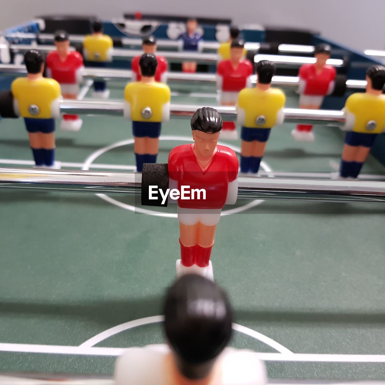 sport, leisure games, competition, soccer, team sport, cooperation, relaxation, leisure activity, male likeness, figurine, teamwork, people, human representation, representation, playing, sports team, indoors, competitive sport, rear view, close-up, sports activity
