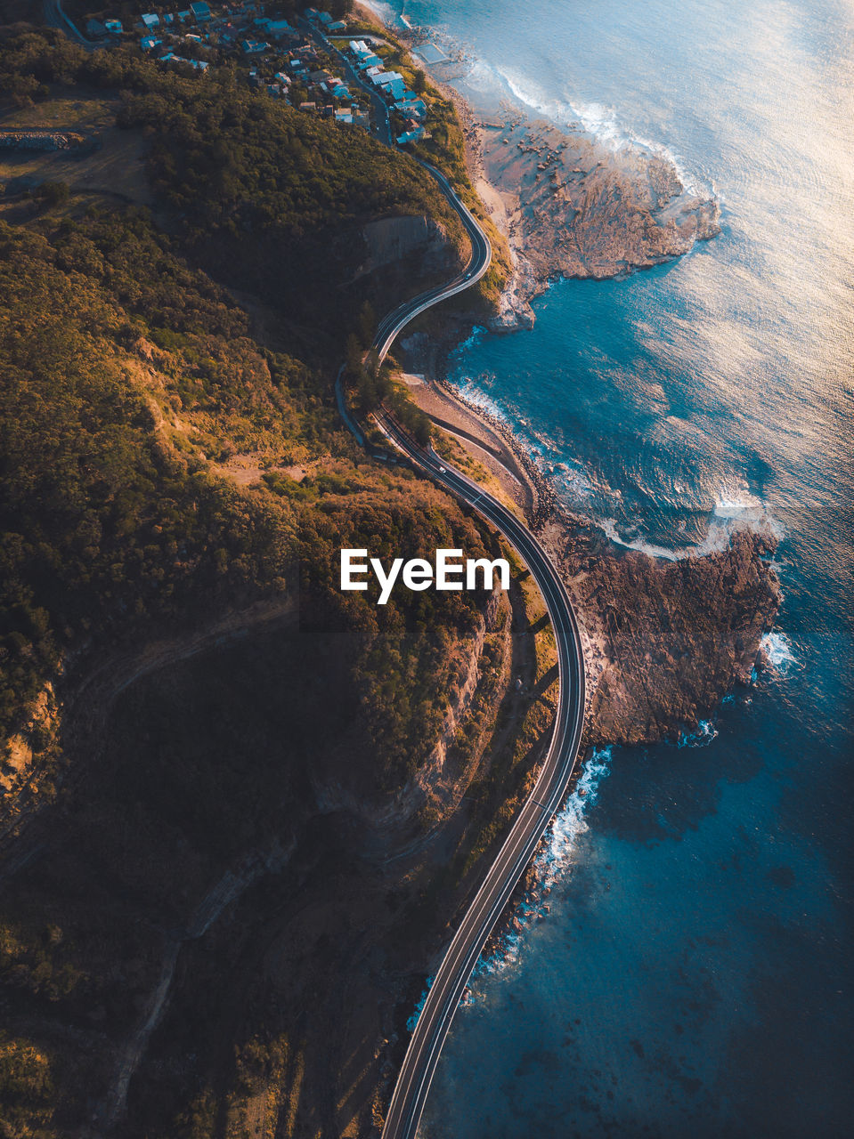 Aerial View Of Winding Road By Sea