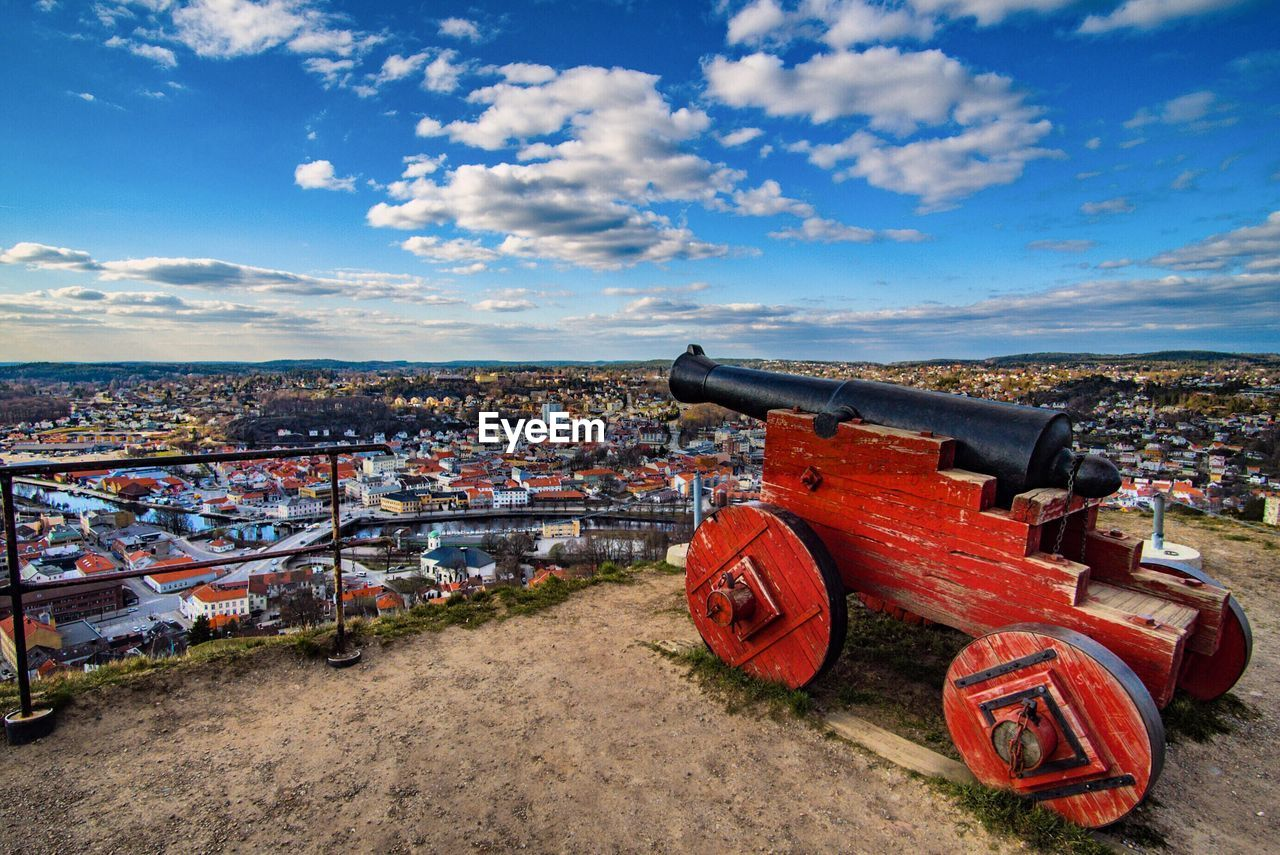 Historic cannon against sky in city